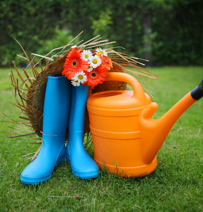 Rubber boots & watering can
